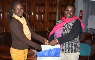 Ms. Hendrina Chalwe Doroba, outgoing Executive Director (right) receives a farewell gift from the Human Resources and Administration Officer Ms. Lilian Nanzala at a farewell party