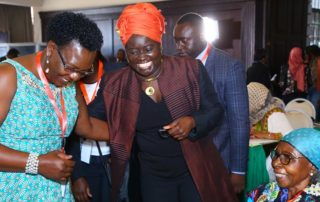 Conference on Education of Girls and Women in Conflict and Post-Conflict situations: Ms. Martha Muhwezi, the current FAWE Executive Director (left) shares a light moment with the founding Executive Director Prof. Eddah Gachukia (seated) and Dr. Codou Diaw, the third Executive Director of FAWE Africa.