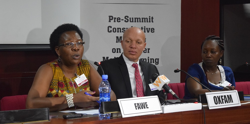FAWE's Martha Muhwezi, Acting Executive Director and the Chair of GIMAC (left) leads the panel discussion on the education of refugees, IDPs, and returnees