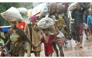 Refugees fleeing the Liberian war Image© https://qz.com/africa/1459254/liberias-civil-war-in-photos-child-soldiers-rape-then-peace/